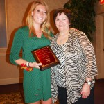 Image of Sarah Hayes accepting the award for Robert Hayes