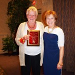 "Image of Isobel ""Izzy"" Dunn accepting Posthumous award on behalf of Robert Dunn and Mary Kay Borkowsk"